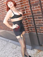 Mature lady in a black girdle