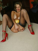 Blonde slut in a girdle and stockings